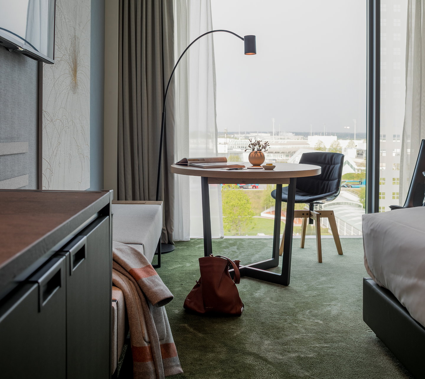joi design creates a mountain hub for the hilton munich airport. Black Bedroom Furniture Sets. Home Design Ideas